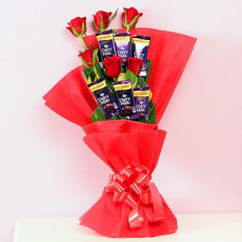 Red roses with chocolate.
