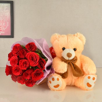 teddy with red roses.